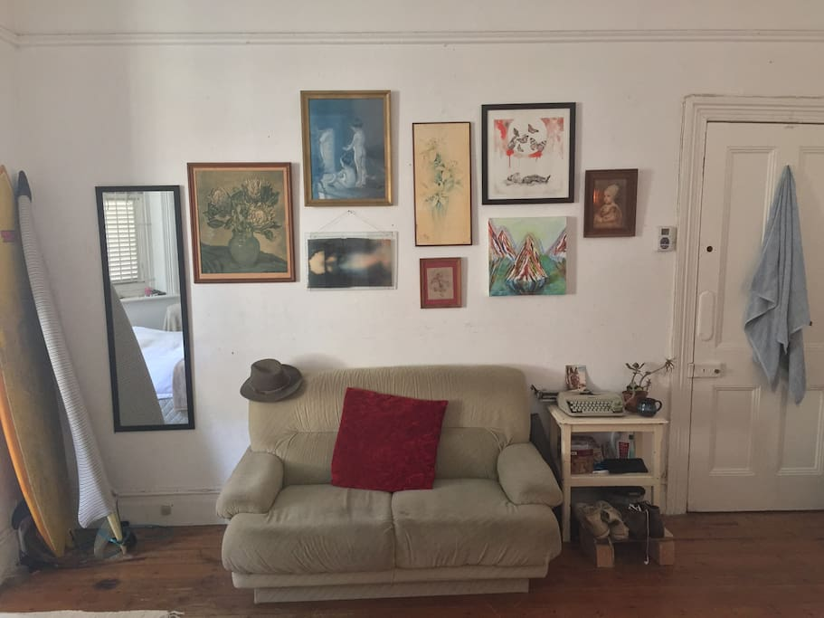 Here is your couch, two tri-finned shortboards, a changing mirror, and art collection from local Cape Town artists.