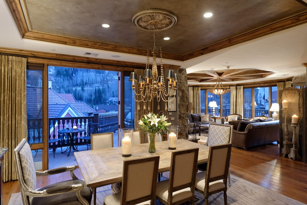 The formal dining area seats eight and overlooks the ski mountain. Adorned with original art and antiques, including a French Regency buffet with vintage stone top and authentic Trumeau plaster mirror with original artwork, the dining area is a fitting backdrop for a memorable meal.