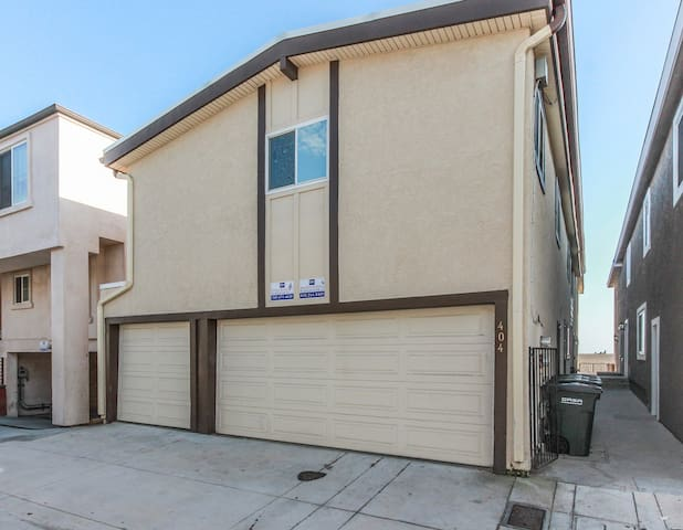 2 car garage on the right included with Upper Unit