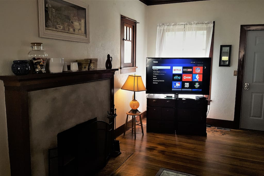 Cozy living room with fireplace and large flat screen TV hooked up to a Roku streaming device. Many channels available including Netflix.