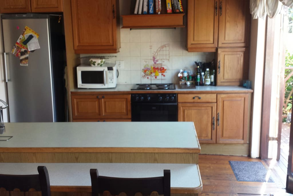 Open plan kitchen with scullery on left of fridge