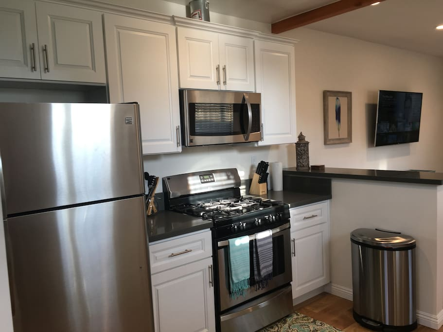 All new stainless steel appliances and cabinets.