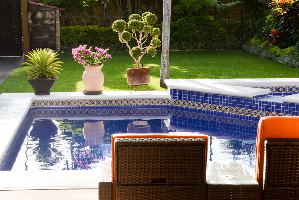 Enjoy the soft early-morning sun by the pool