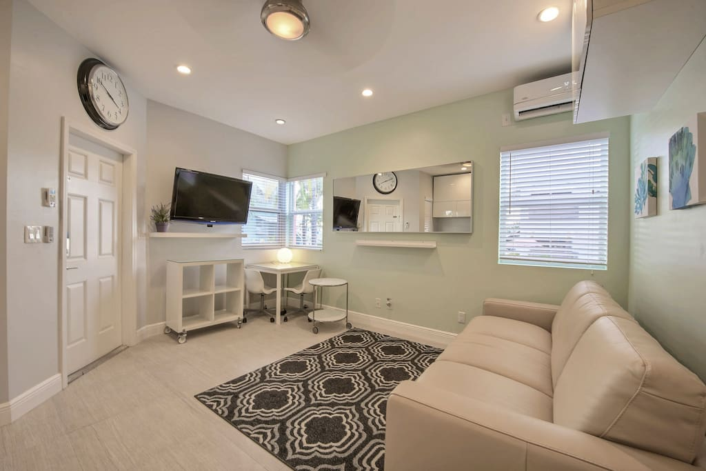 Enjoy a movie on the wall-mounted flat screen TV in the living room