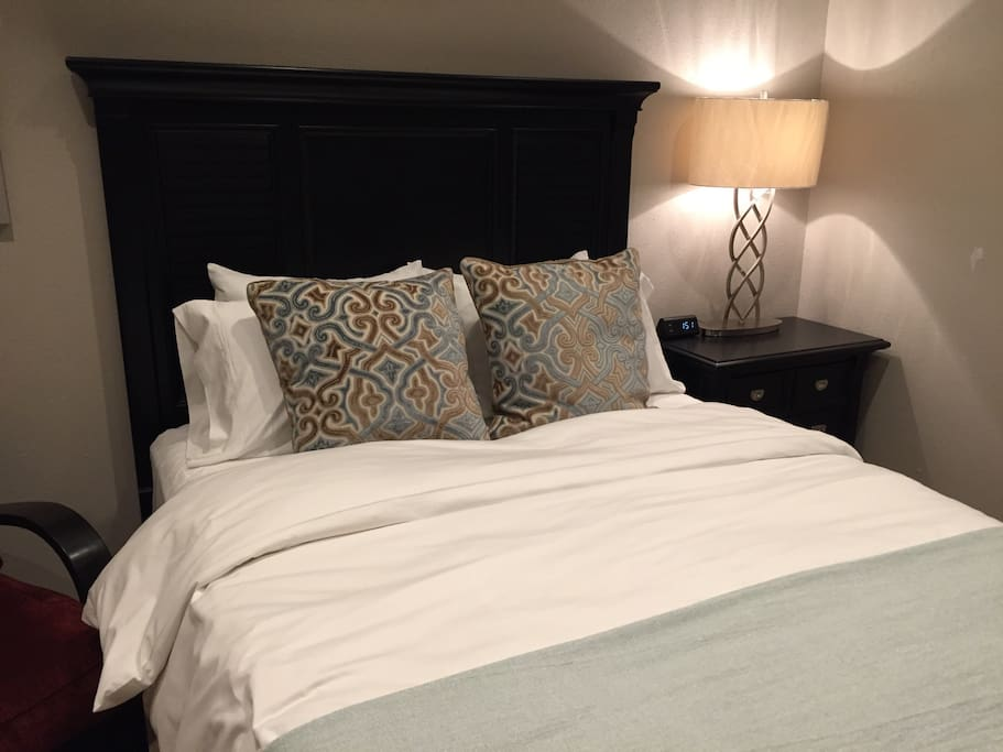 Queen size bed with down comforter for your comfort.