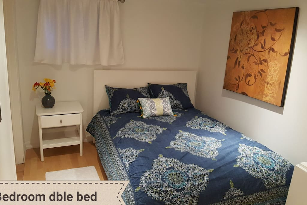 Double bed bedroom includes dresser and large closet