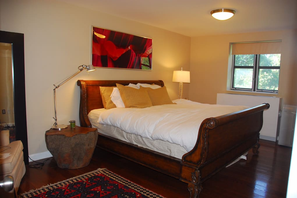 Master's bedroom with a private full bathroom and a king size bed