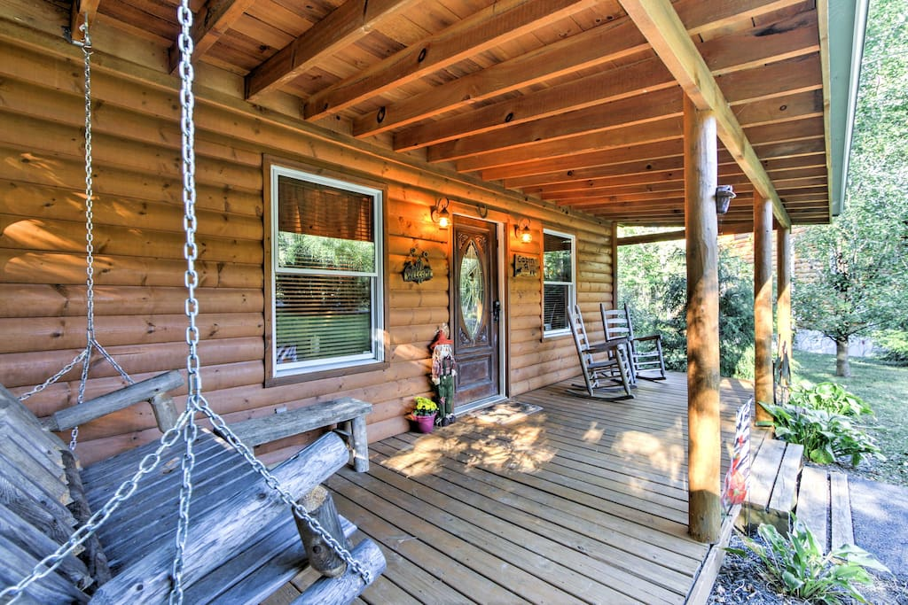 Relax on the front porch with views of the acre of forested land.