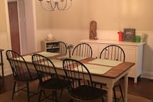 Large dining room which seats 6 comfortably. Dimmable chandelier for various levels of ambiance ;)