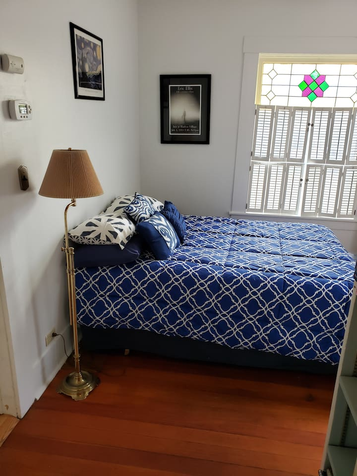 Bedroom with double bed, closet and dresser