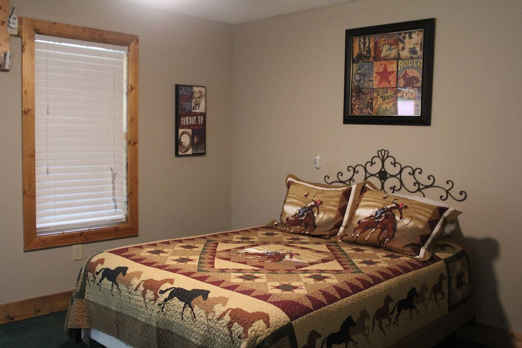 Queen bed located at entrance.