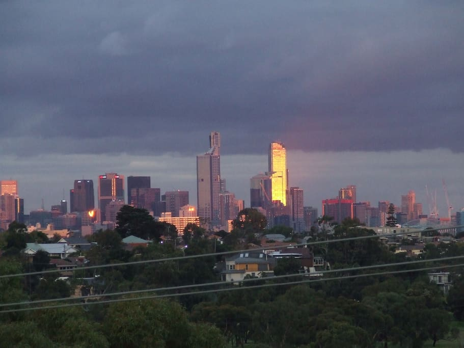 East facing balcony views of Melbourne CBD ideal for sunsets highlighting city buildings.