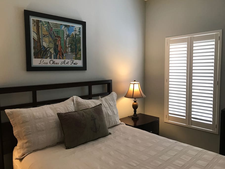 Queen bed, with 2 end tables, beautiful large dresser and mirror in the bedroom.