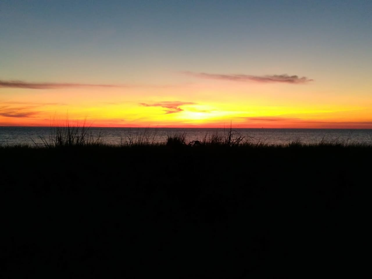 Beautiful sunsets over the bay just 1.5 blocks from the house.