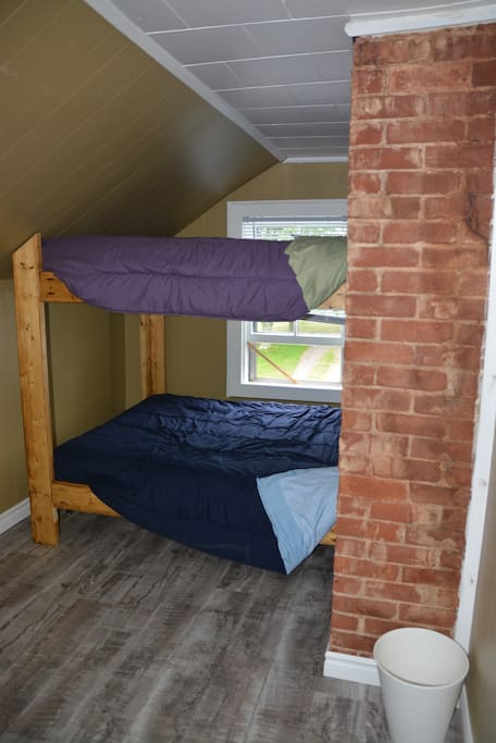 Double Bunk Room surrounded by warmth of the original brick of the chimney