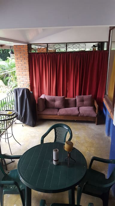 Guests have access to the quaint outside terrace with full couch for relaxing and another set of table and chairs for eating breakfast outside and enjoying the sound of the river and lovely trees.