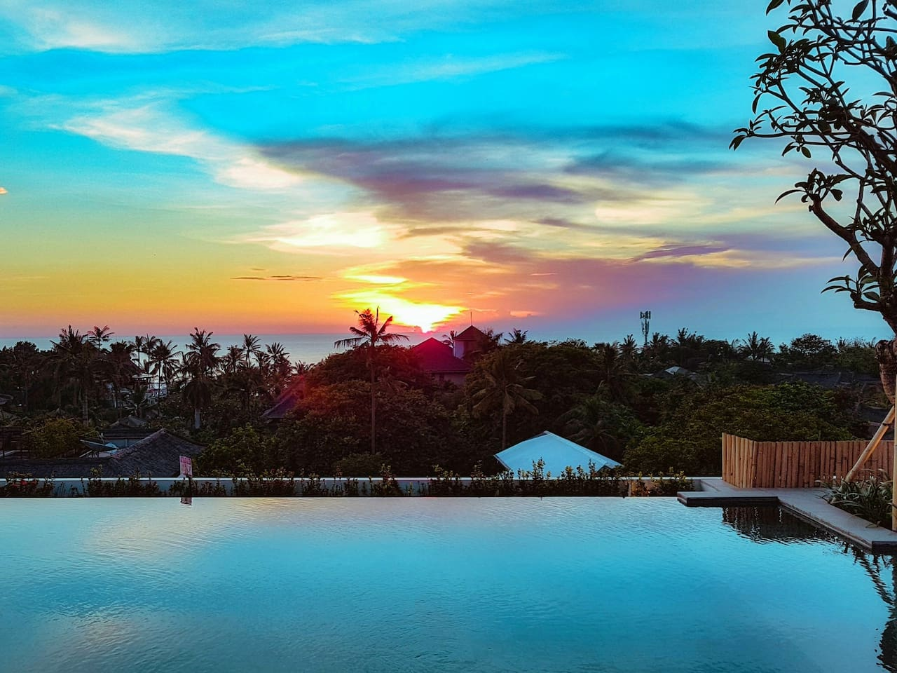 Infinity Rooftop Pool with Romantic Sunset