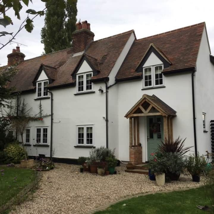 Spacious bedroom and ensuite in converted cottage