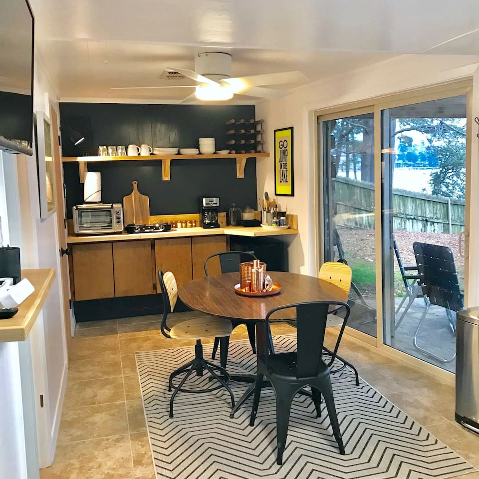 COMPACT but efficient floor plan offers a small space to eat, sleep and live while being a few steps from the lake and the private dock.    For those that need to work, use the table as a work space or sit outside on the patio's hanging twin bed.