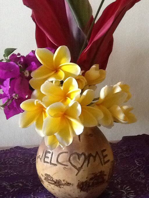 Welcome coconut with fresh flowers from our hostess