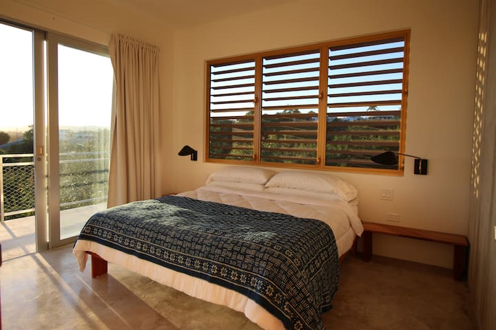 Bedroom #1 with king size bed, balcony with ocean views and private bathroom.