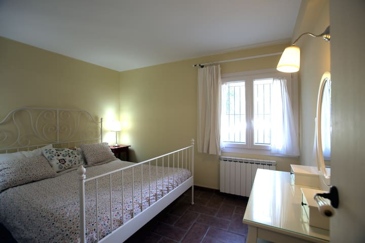 Bedroom with a double bed and dressing table with stool, which can be also used as a work place for your computer.