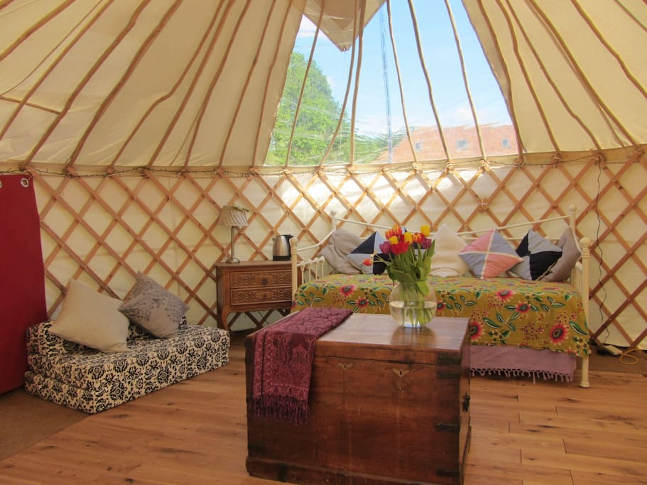 The beautiful 'Living Room Yurt' complete with day bed, trundle and futon.