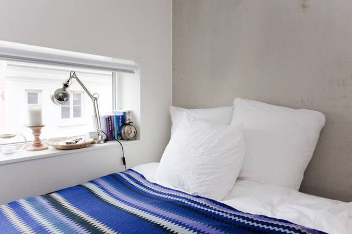 Both rooms face a quiet backyard.