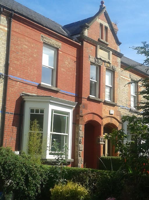 3 storey, period red-brick house with original features & bay-windows, remodelled by it's architect owners