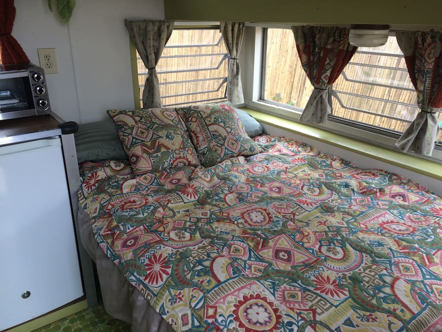 Plush double bed with canyon breezes and sunshine streaming in