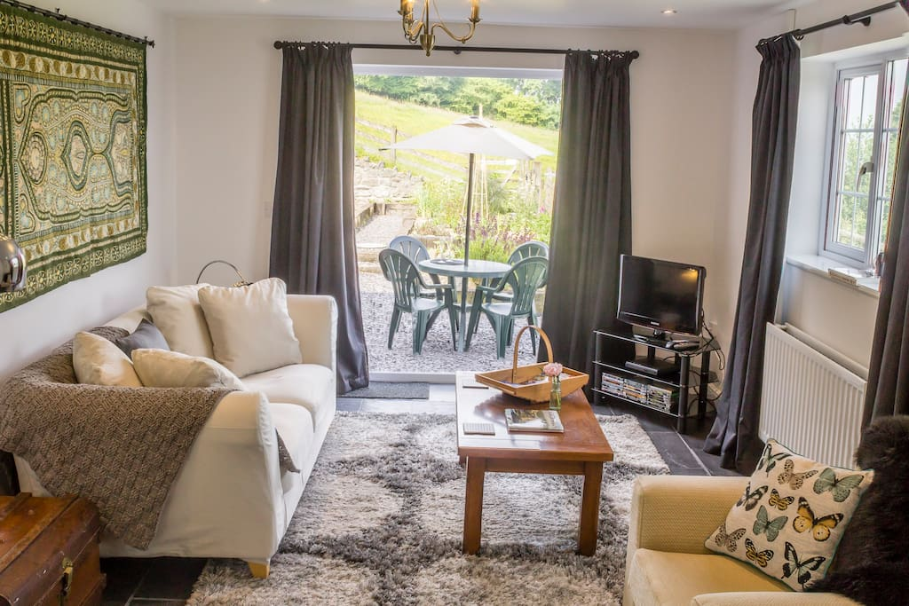 The spacious living room leading out to Hillside's private garden has Freeview TV, HDMI cable for laptop plugin, DVD player and a choice of DVDs.
