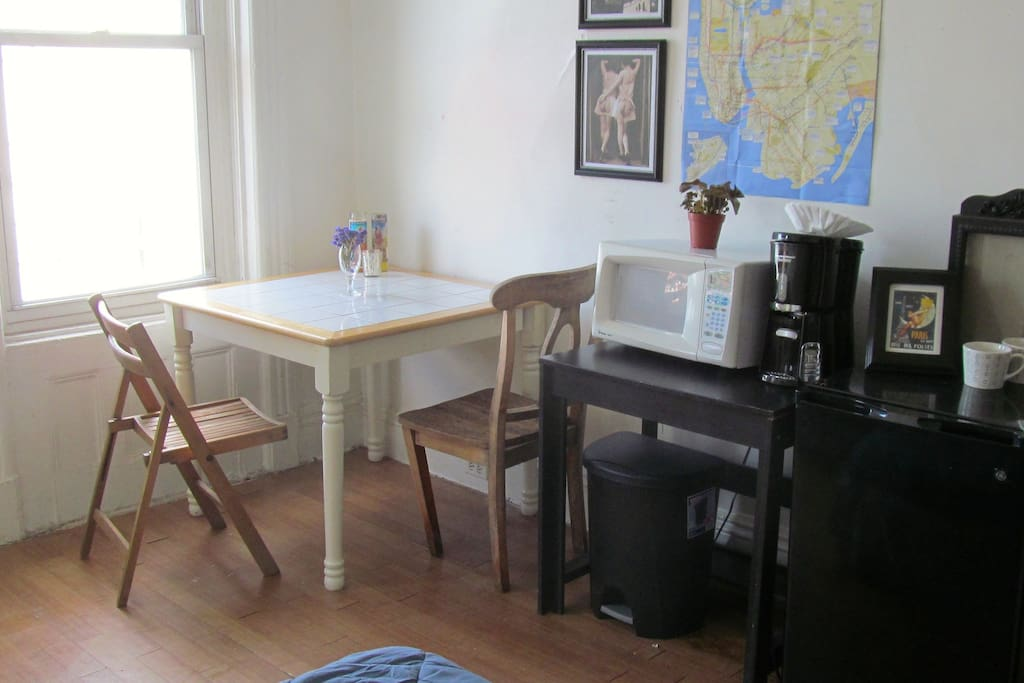 table and  chairs, microwave, coffee maker and mini fridge