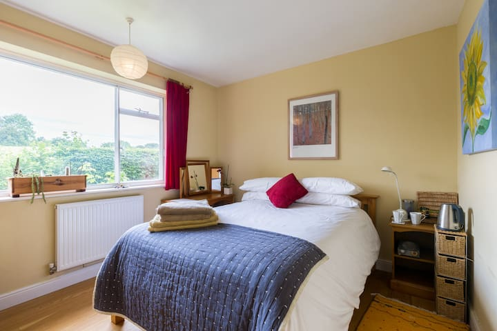Your South facing bedroom overlooks an unused field. It has a really comfy bed. Plead note: it's a STANDARD double, not king size.