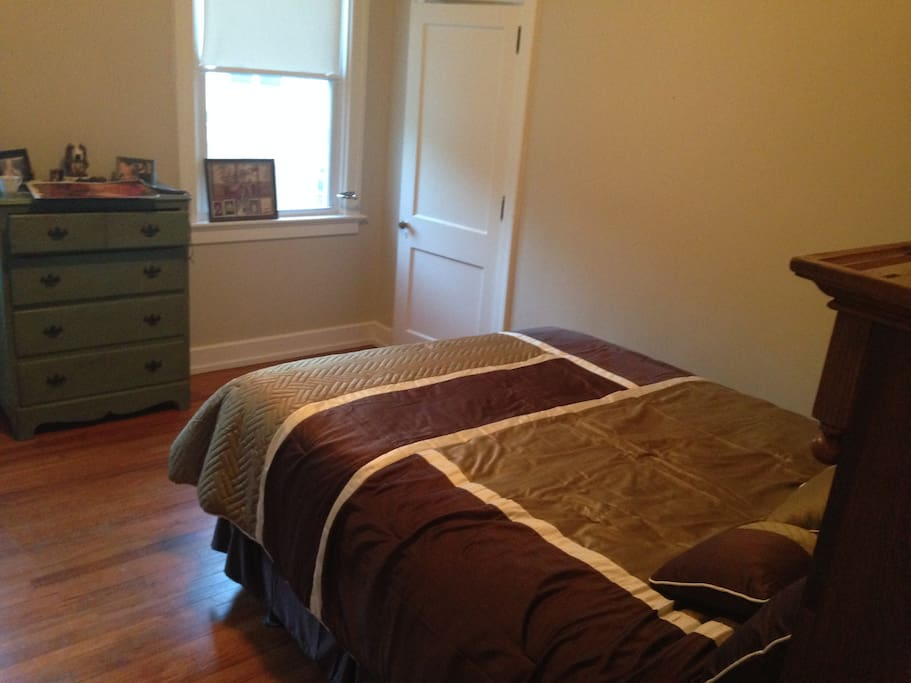 Room 1: Queen bed, antique dresser, closet.