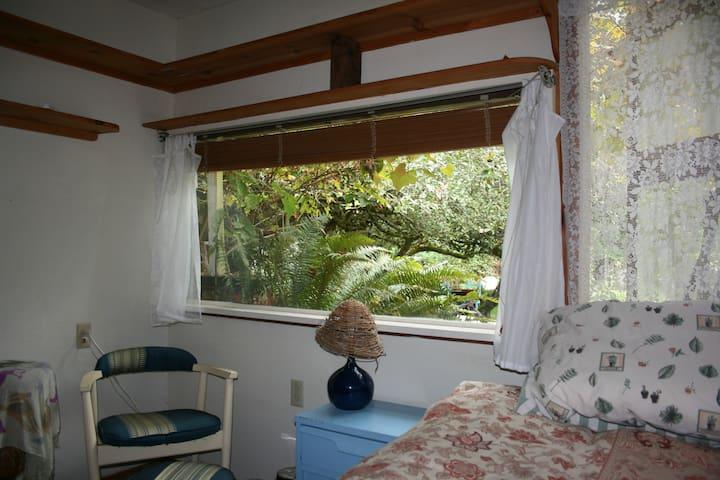 room in cozy, artsy cottage