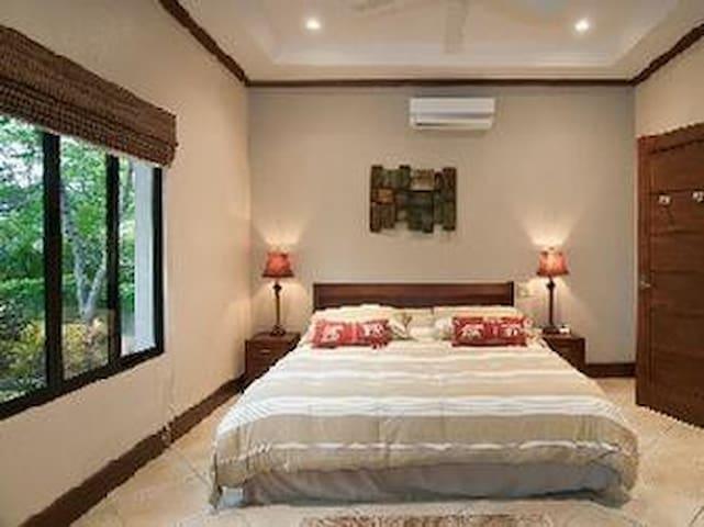 Lower Poolside Bedroom Suite