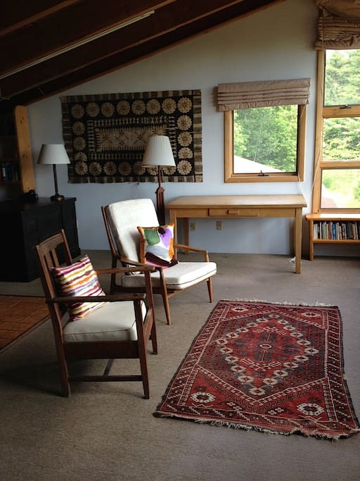 The top floor master bedroom doubles as a library and study. The ceilings are about 15 feet high, and the windows look out on Lake Willoughby and Mount Wheeler (note that in the summer when all the leaves are out the lake is not very visible, even though it is pretty close)