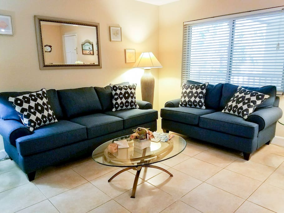 Unwind on 2 comfortable sofas in the living room.