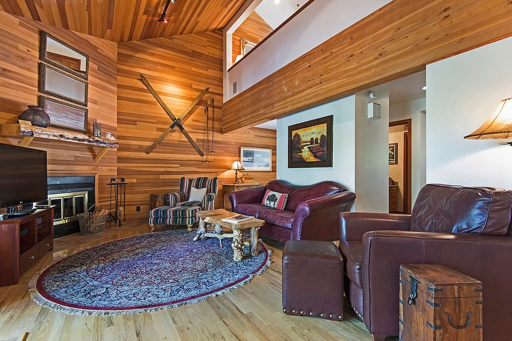 Living Area includes Large TV with Wood Burning Fireplace