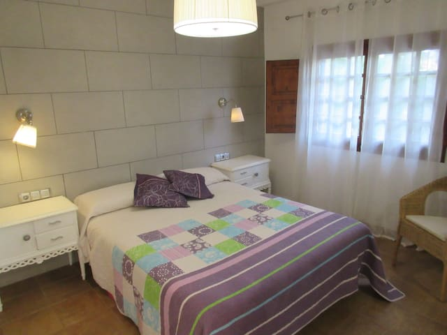 1st bedroom with double bed and dresser.