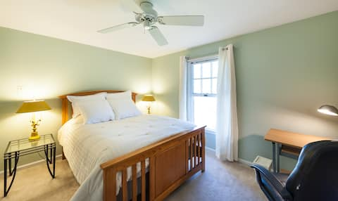 A spacious upstairs corner room with luxury bed and linens