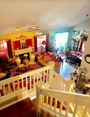 The view of the lower level from the upper level of the house...living/dining combo.