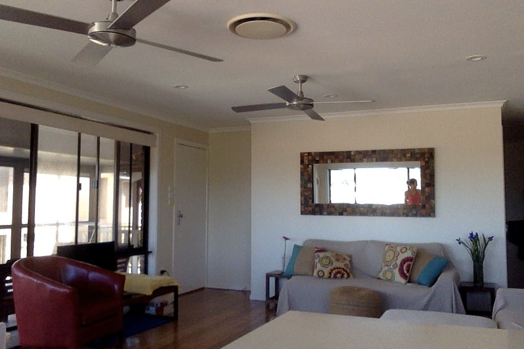 Open plan living and dining area looking onto balcony