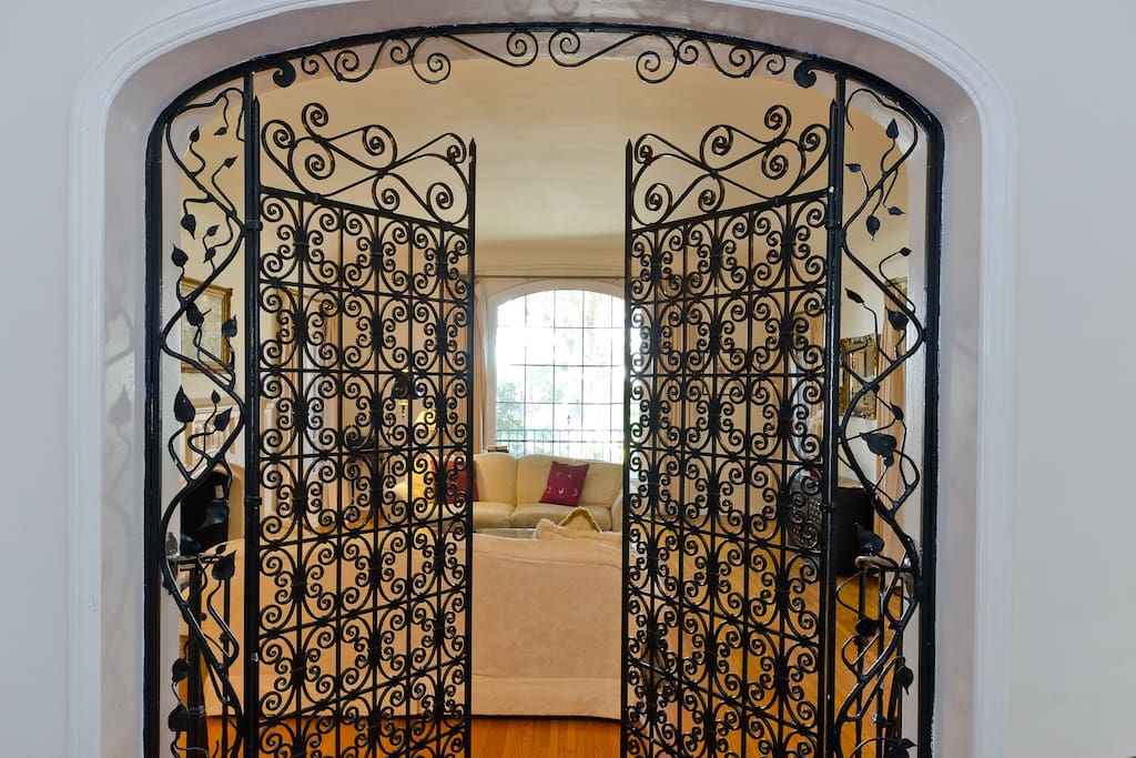 Incredible Period Hand Made Wrought Iron Gates leading from living from into the family room