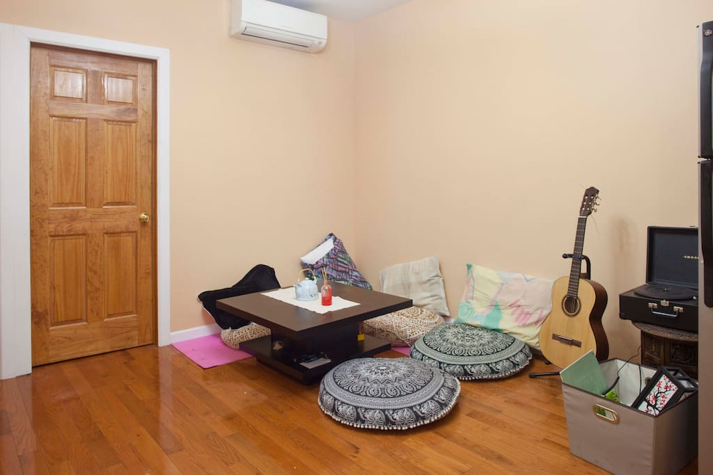 This is our living room - complete with plushy cushions for your bums and good music for your soul!
