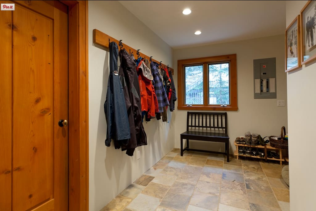 spacious mud room with heated floors, enter from the front door or from the garage