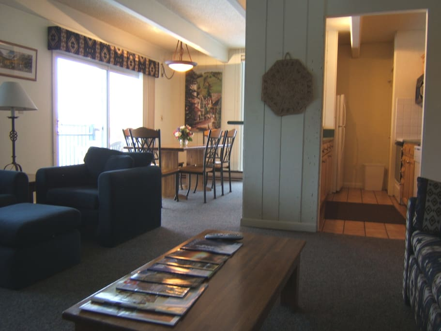 Living and dining areas and kitchen  all have broad views to Vail Mountain.