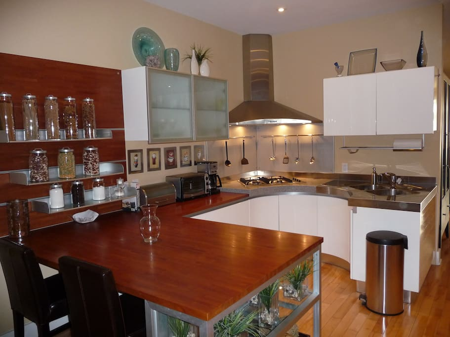 Gorgeous kitchen with plenty of counter space; bistro breakfast seating. Design from Italy. Plenty of dishes, cooking utensils, etc. Gas stove, dishwasher, oven, microwave, huge fridge and plenty of pantry space.