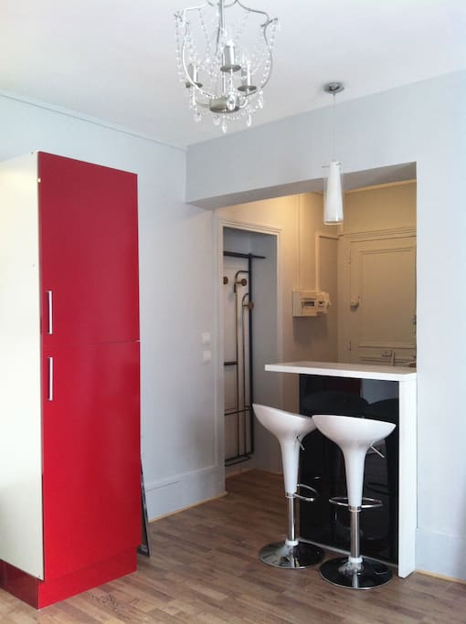 bar for two and red fridge