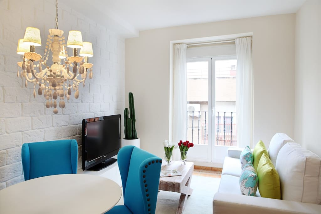 Living-dining room with enough space to enjoy a meal or rest in a comfortable sofa.